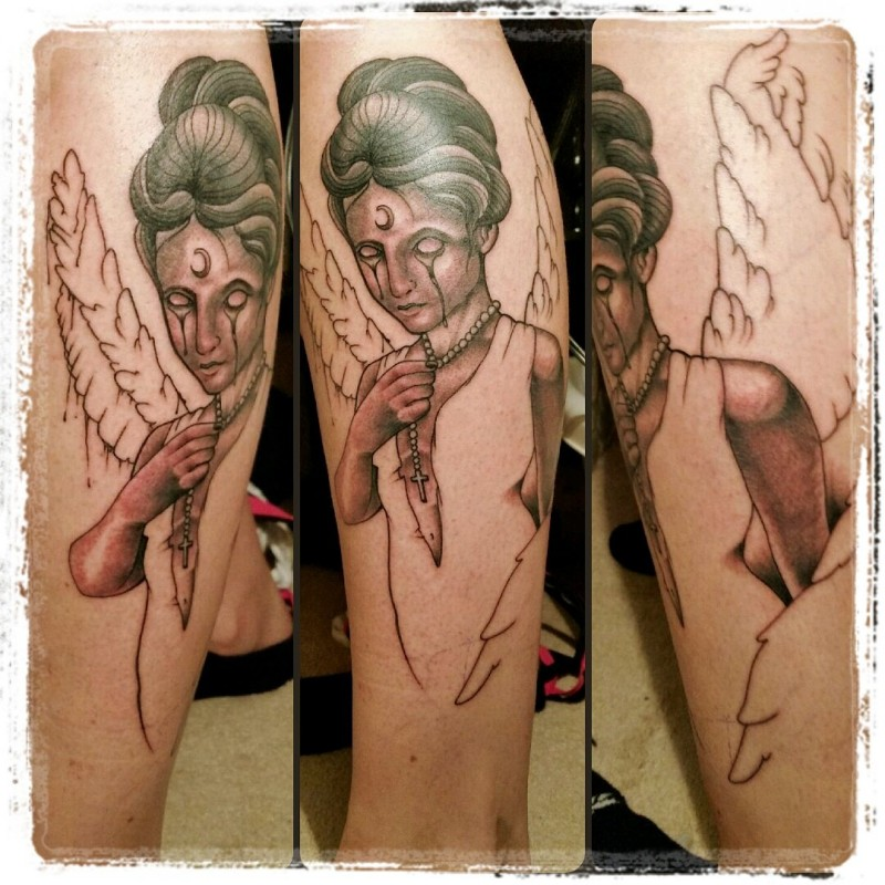 Unfinished colored leg tattoo of mysterious angel with moon