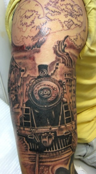 Unfinished enormous half sleeve tattoo of train combined with large tree