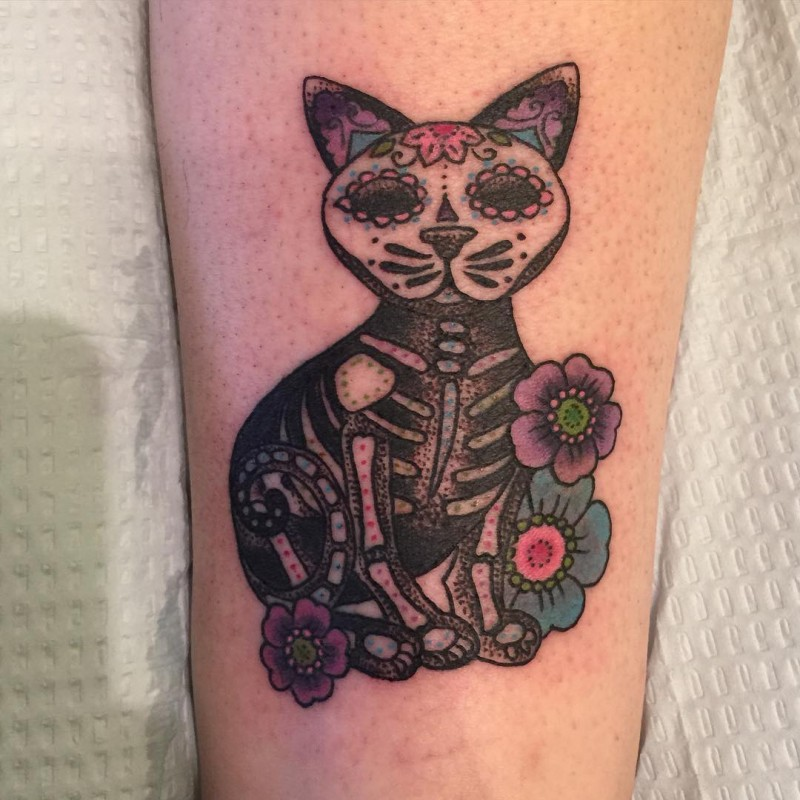 Illustrative style colored arm tattoo of Mexican traditional cat with flowers