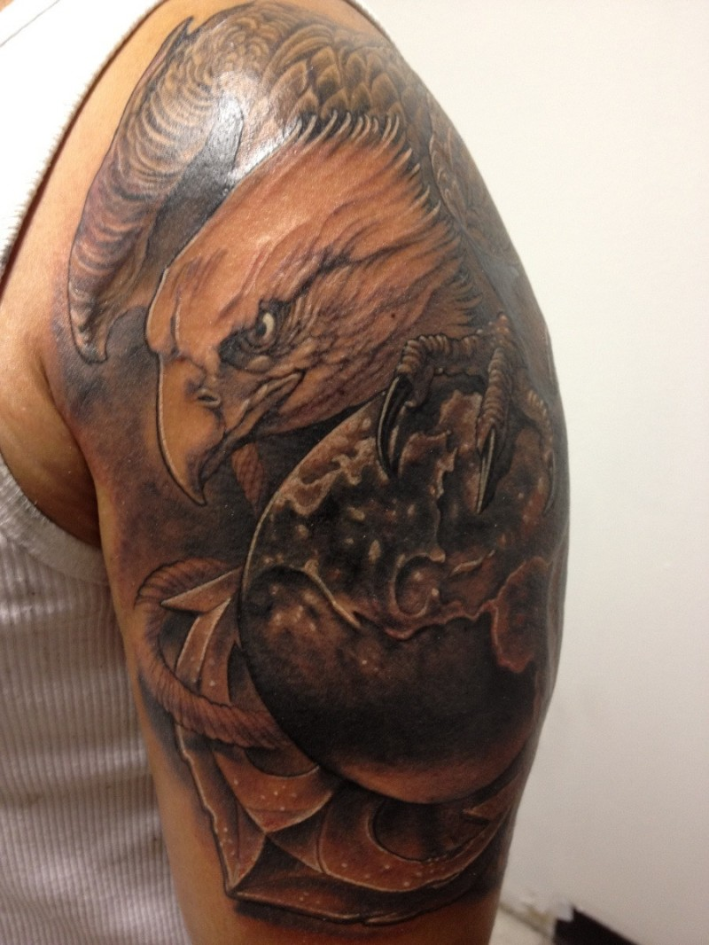 Illustrative style colored shoulder tattoo of eagle with globe and anchor