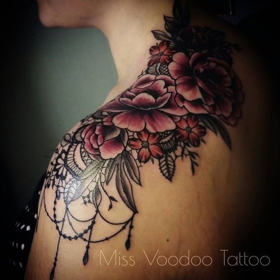 New school style colored shoulder tattoo of flowers by Caro Voodoo
