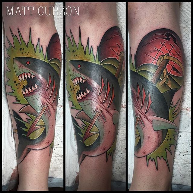 New school style colored leg tattoo of bloody shark with harpoon