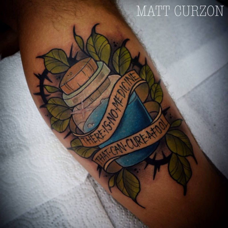 New school style colored leg tattoo of small potion with lettering and leaves