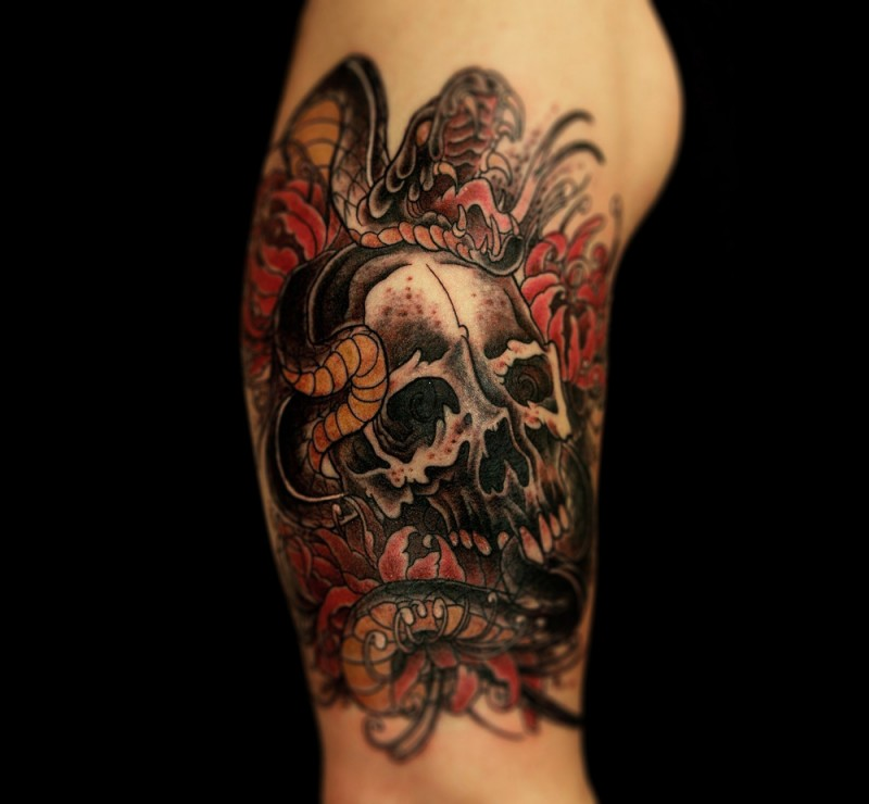 New school style colored shoulder tattoo of human skull with snake