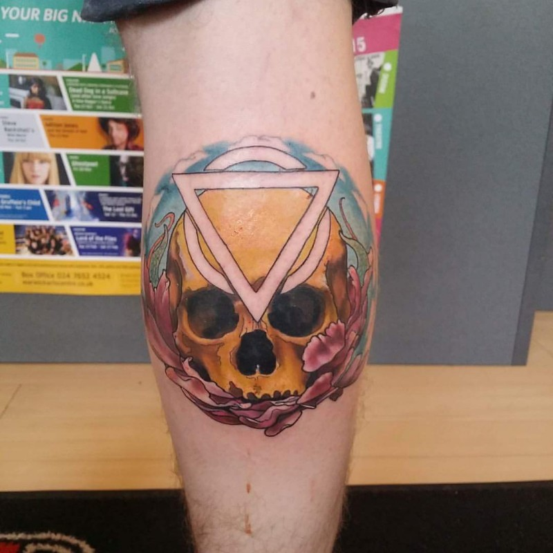 New school style colored leg tattoo of human skull with mystical symbol