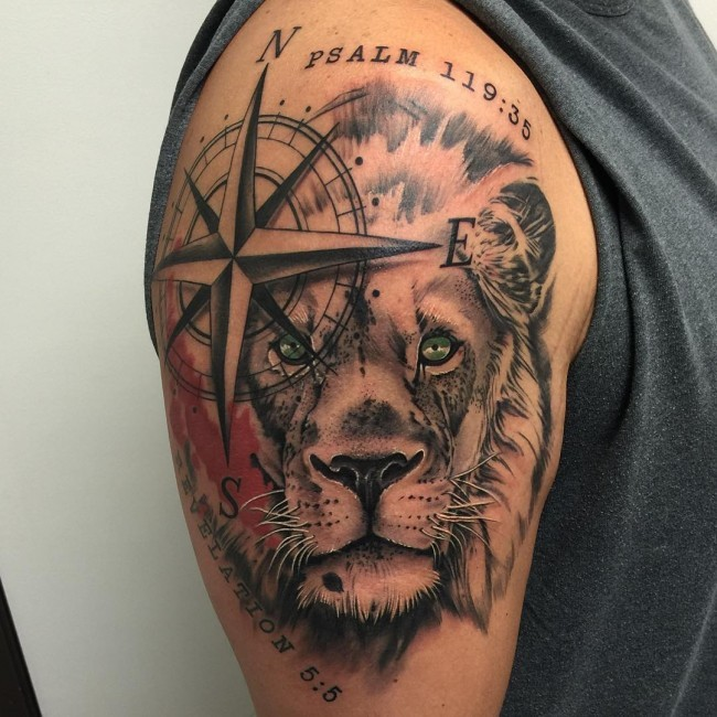 Unusual combined colored lion head tattoo on shoulder with nautical star and lettering
