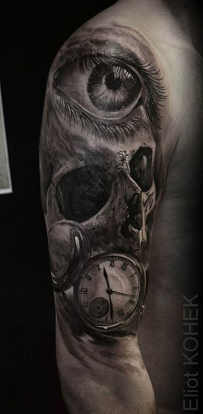 Unusual combined detailed upper arm tattoo of human skull with woman eye and clock