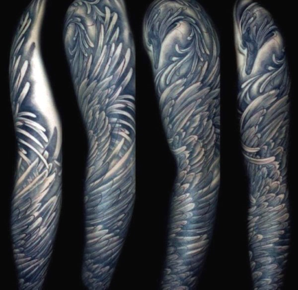 Unusual style painted and colored massive feather wing tattoo on sleeve