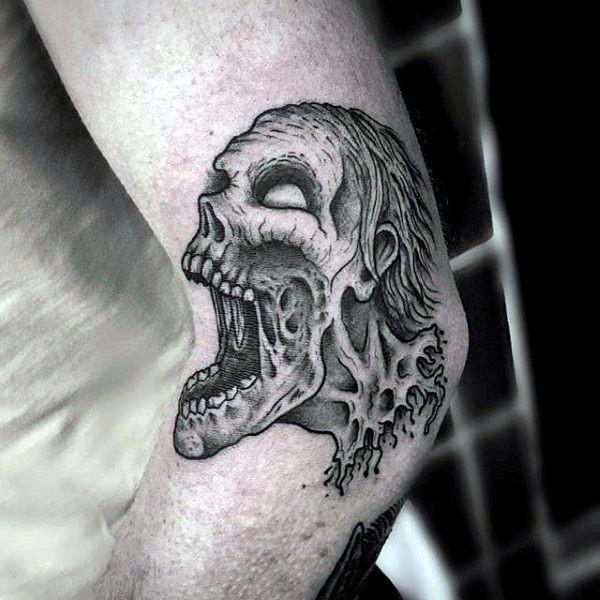 Vintage black ink elbow tattoo of creepy monster zombie