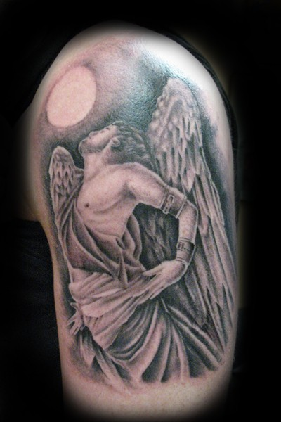 Vintage picture style detailed shoulder tattoo of Icarus statue with sun