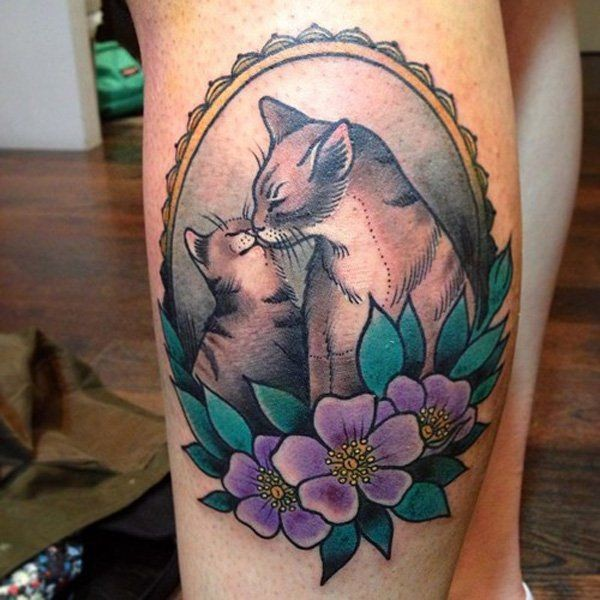 Vintage style colored leg tattoo of cat family with flowers