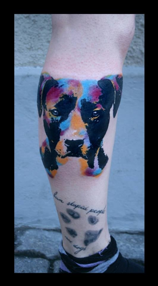 Watercolor portrait of a dog and paw print tattoo