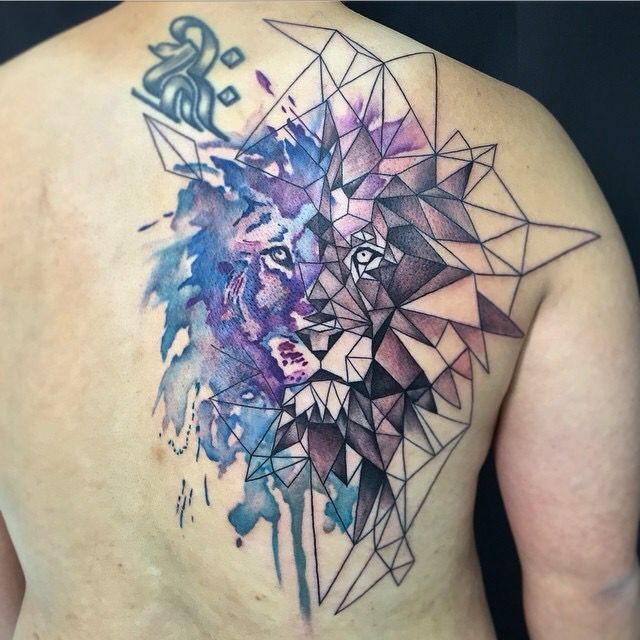 Watercolor style amazing looking scapular tattoo of lion portrait with geometrical figures