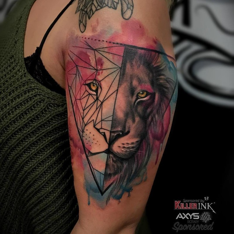 Watercolor style colored shoulder tattoo of steady lion head with triangles