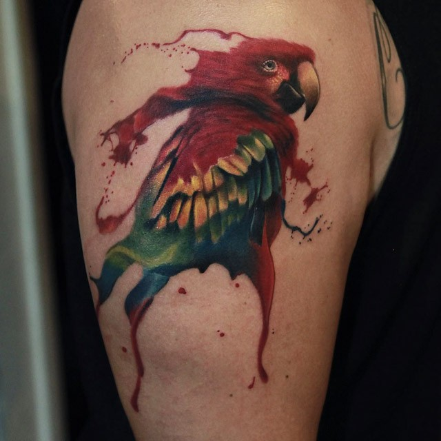 Watercolor style colored shoulder tattoo of funny parrot