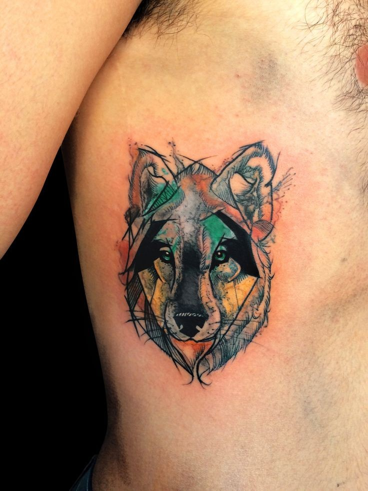 Watercolor style colored side tattoo of small wolf portrait