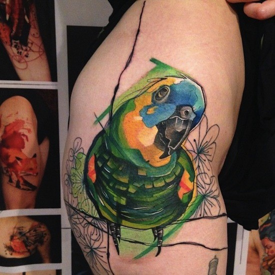 Watercolor style colored tattoo of cute parrot