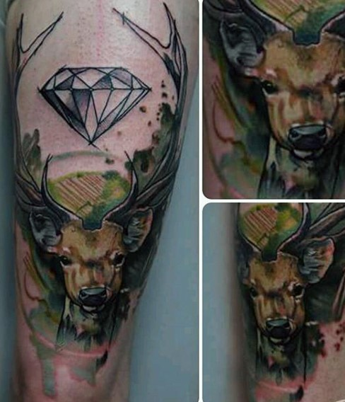 Watercolor style colored thigh tattoo of deer with big diamond