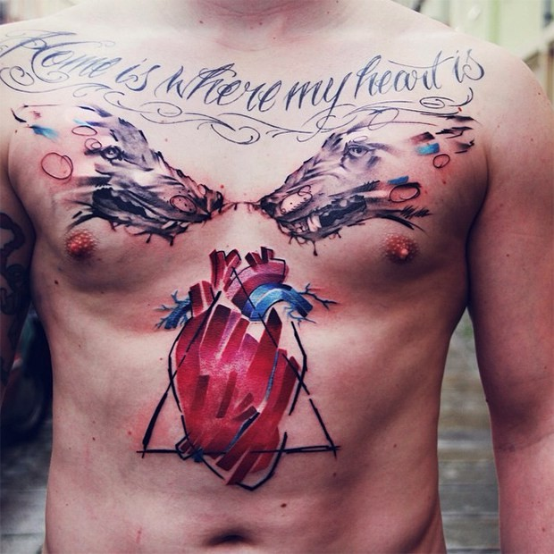 Watercolor style impressive looking chest and belly tattoo of evil wolves with lettering and heart