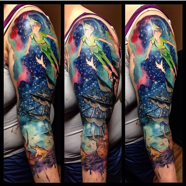 Watercolor style painted colorful half sleeve tattoo of Peter Pan and sailing ship