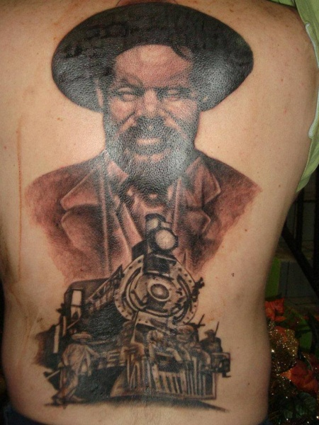 Wester style colored whole back tattoo of train and man portrait