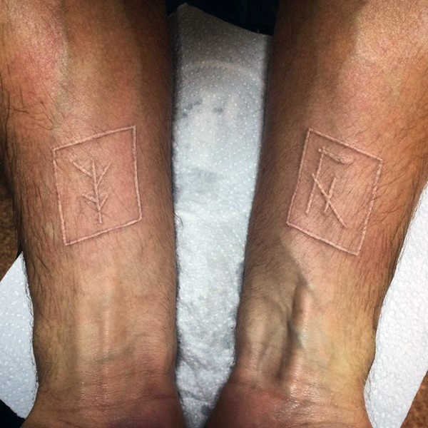 White ink special symbols in boxes tattoo on both arms