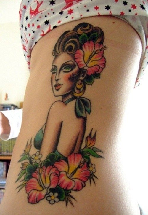 Woman and hibiscus flowers tattoo on ribs