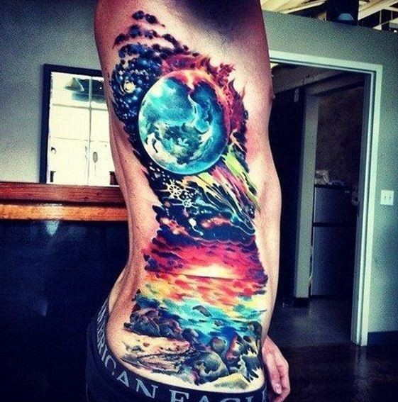 Wonderful colorful space tattoo on ribs