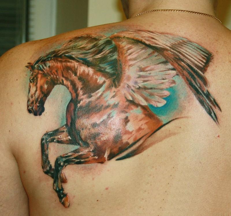 Wonderful coloured dark horse pegasus tattoo on shoulder blade
