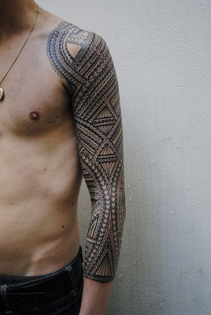Wonderful polynesian tattoo on full sleeve