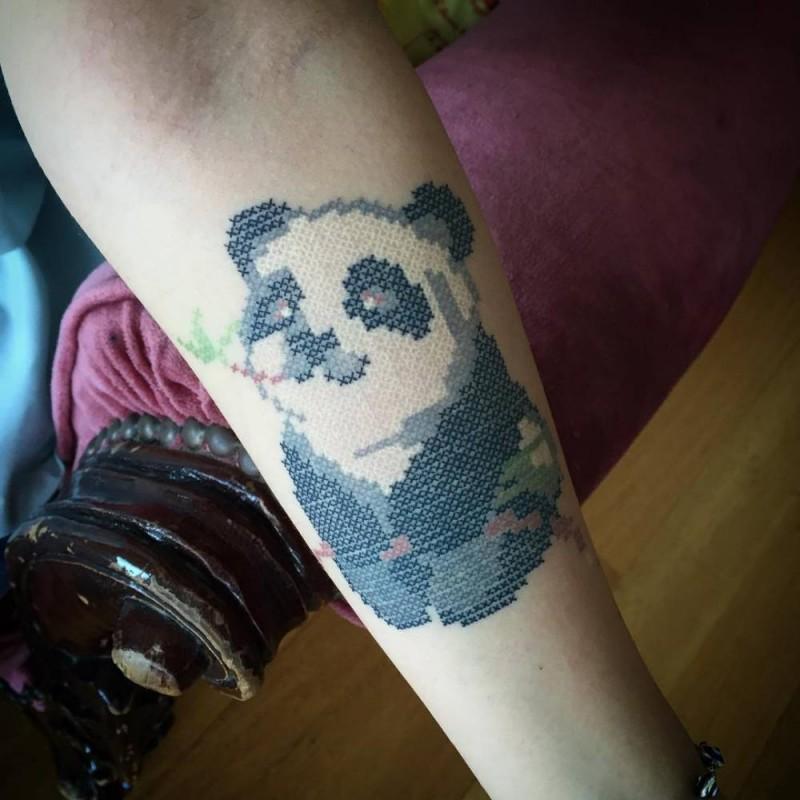 2D style colored forearm tattoo of funny cartoon panda