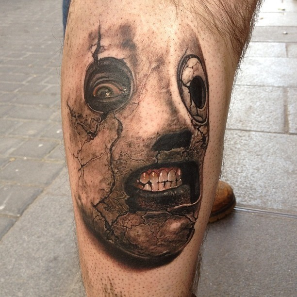 3D very detailed leg tattoo of famous musician horror mask