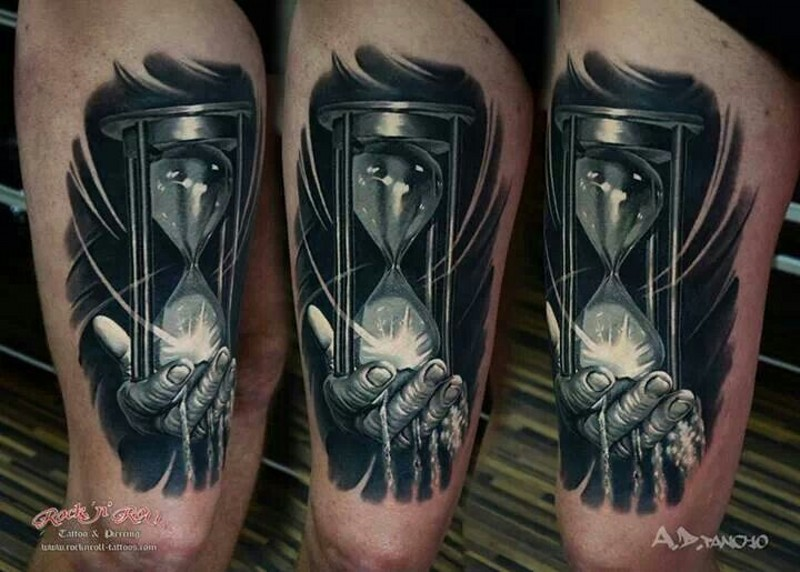 3D black and white broken sand clock tattoo on thigh