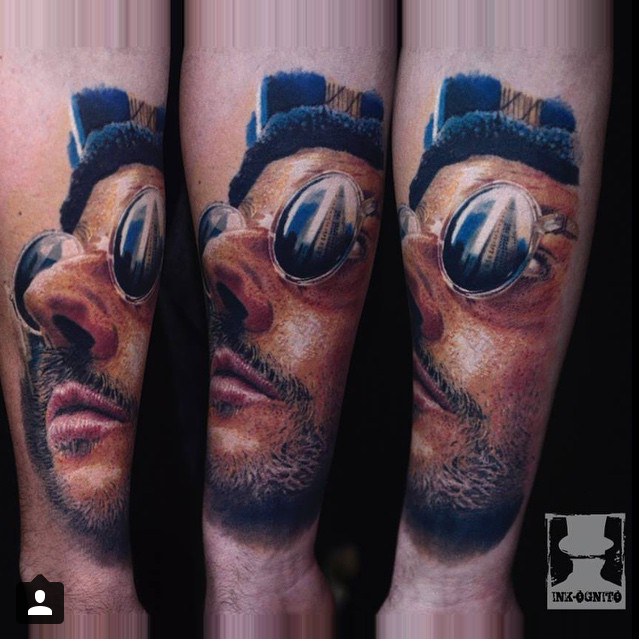 3D colored forearm tattoo of man portrait with sunglasses