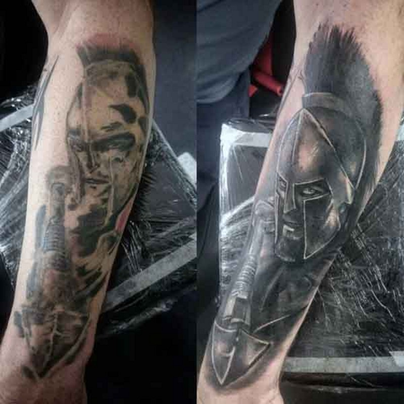 3D detailed black ink forearm tattoo of angry Spartan warrior
