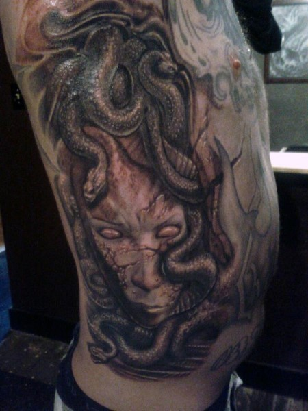 3D detailed colorful medusa head tattoo on side