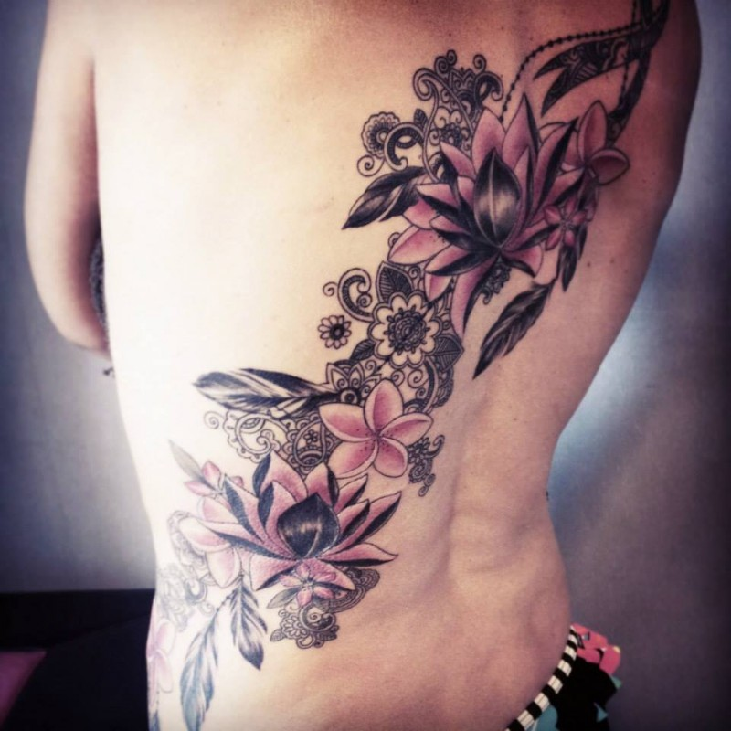 3D large colorful whole back tattoo of flowers by Caro Voodoo