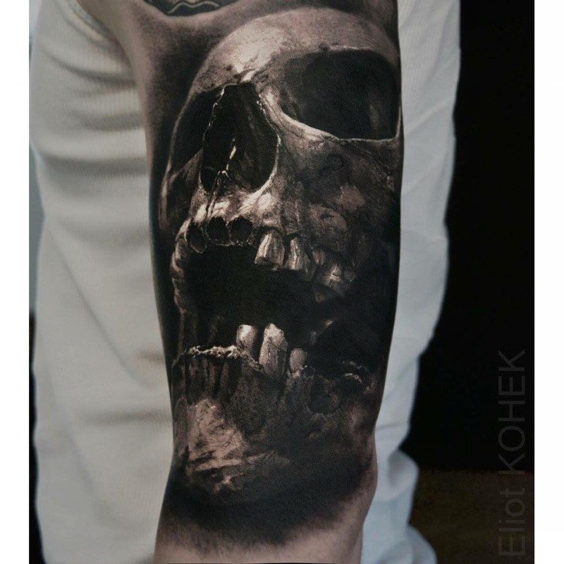 3D lifelike very detailed arm tattoo of human skull by Eliot Kohek