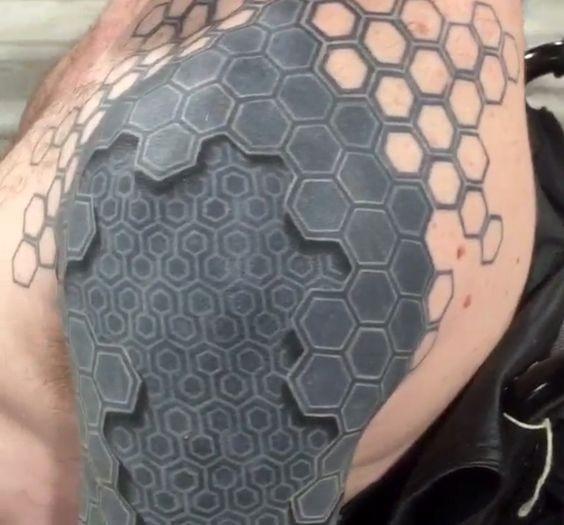 3D like big black and white biomechanical tattoo on shoulder