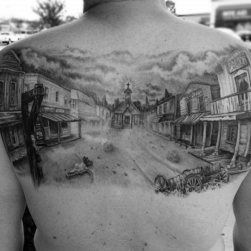 3D like big black and white old western town tattoo on upper back