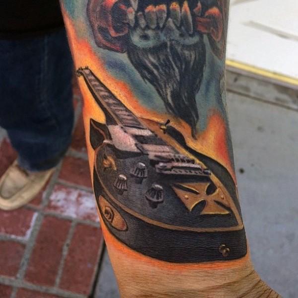 3D like big colored guitar tattoo on wrist