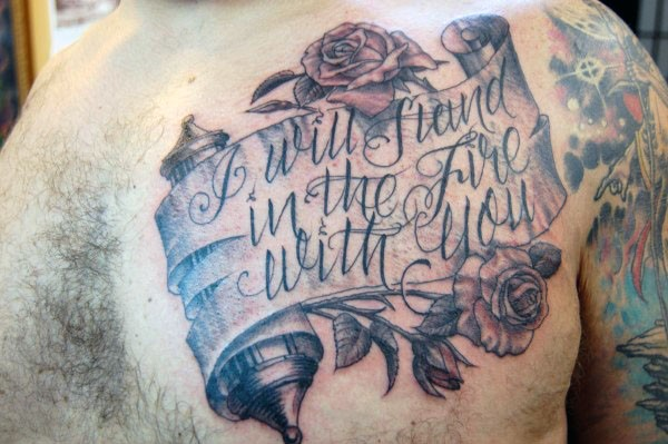 3D like big old lettering with flowers tattoo on upper back