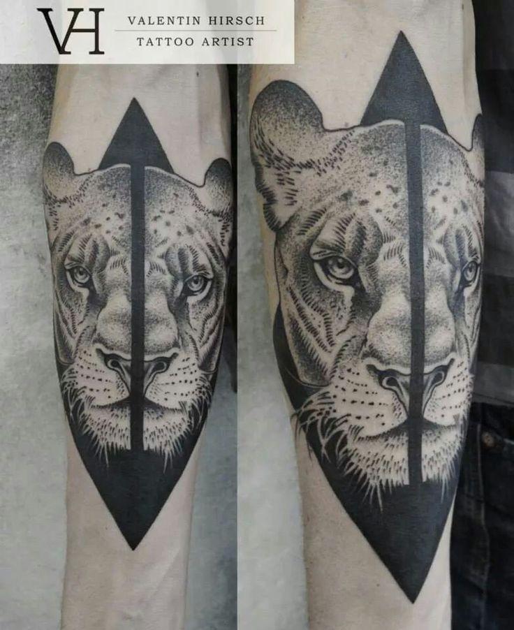 3D like black ink forearm tattoo of split lion head by Valentin Hirsch