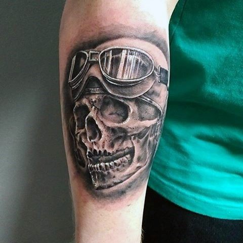 3D like black ink old riders skull in helmet tattoo on arm