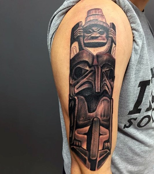 3D like colored ancient tribal statue shoulder length  tattoo