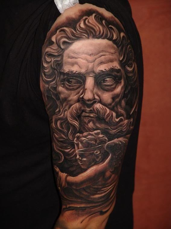 3D like colored antic statue tattoo on shoulder with little angel