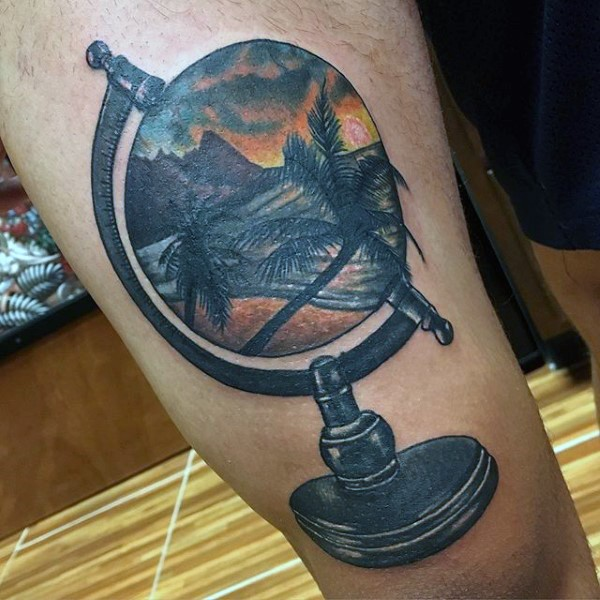 3D like colored little globe stylized with ocean shore and palm tree tattoo on thigh