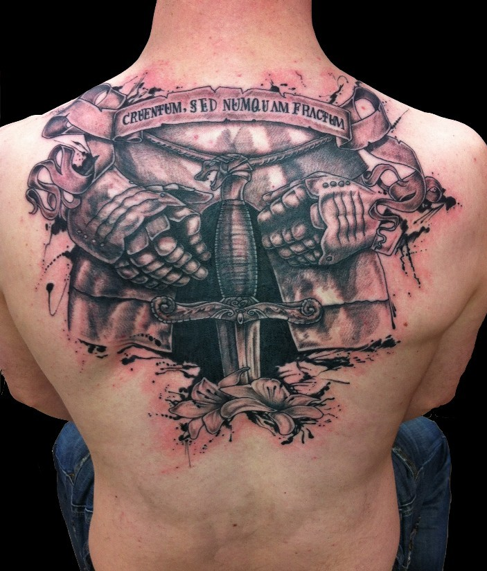 3D like colored medieval armor with sword and flowers tattoo on upper back stylized with lettering