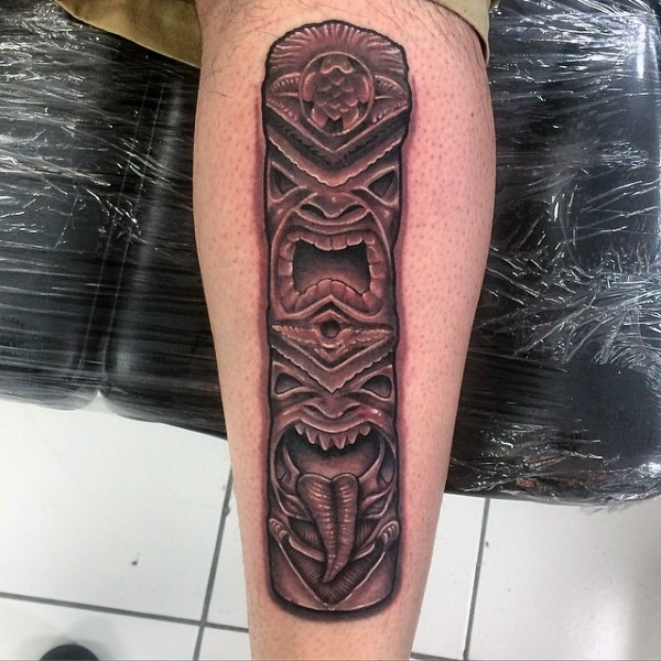 3D like colored tribal old statue tattoo on leg