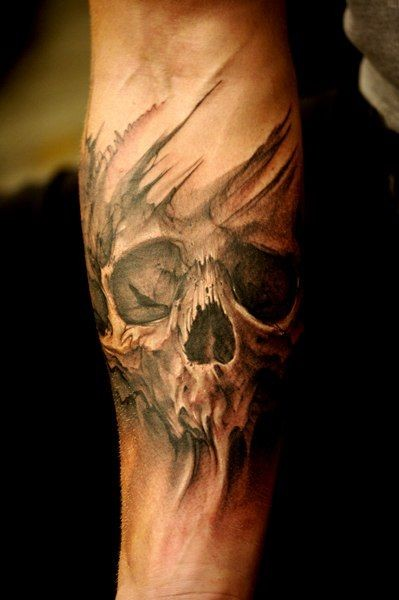 3D like detailed black and white old skull tattoo on arm